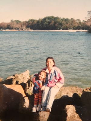 Angel Jones as a child with her mother in front of a lake