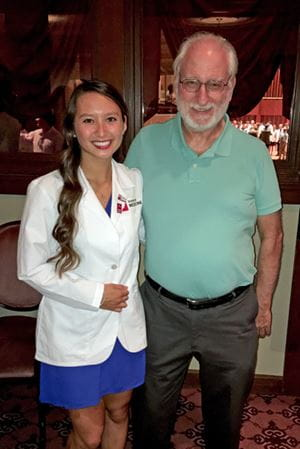 Angel Jones with her father at her white coat ceremony