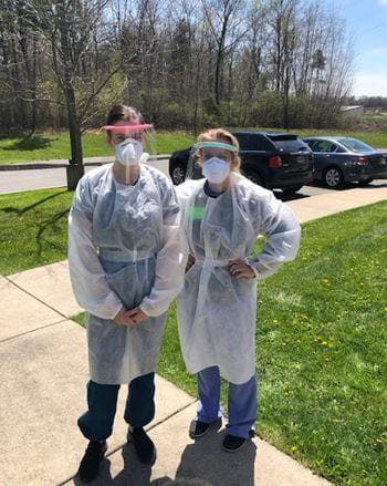 MD students Anna Fenner and Courtney Raab volunteer with the Indiana Department of Health to swab for COVID tests