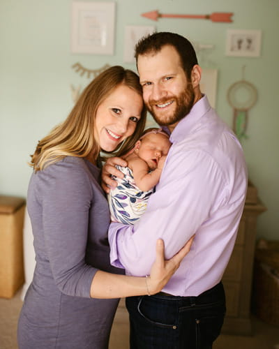 Dr. Ashley Satorius and Dr. Matt Rutz, dual IUEM physician faculty, with their daughter Raegan.