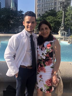 Christian Arce Guzman with his mom at white coat ceremony