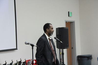 Clark Simons MD speaks at a community event