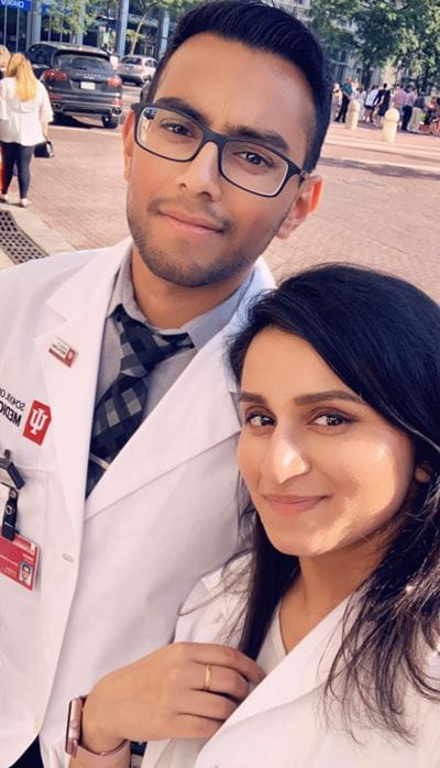Harjas Singh and Harleen Kaur in white coats