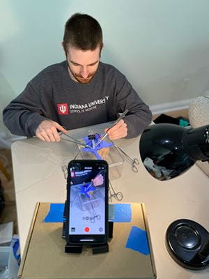 IU School of Medicine Student Joshua Matthews records demonstration of appendectomy surgery while recording on an iphone.