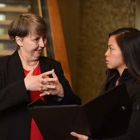 Regina Kreisle, MD, PhD talking with a student