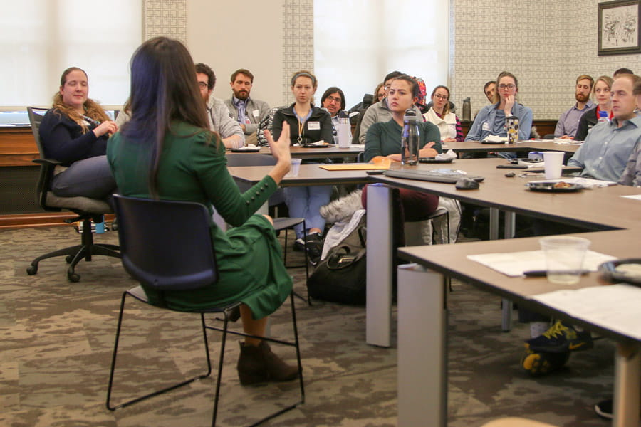 New residents listen to a presenter at a recent half-day conference