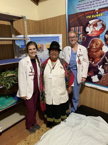 Sydney Rivera with a midwife and colleague in Ecuador