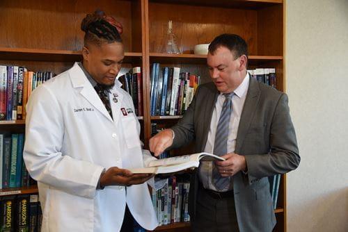Derron Bishop with medical student Darren Bost Jr.