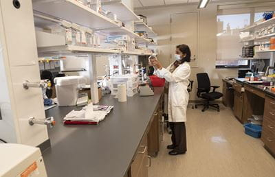 Photo of lab member working in the lab