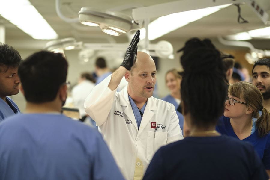 Andrew Deane, PhD, instructs students in the anatomy lab at IU School of Medicine.